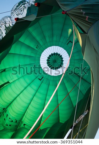 Interior of a bright green hot air balloon about to take off - stock photo