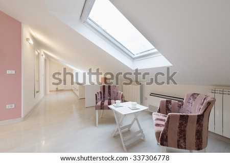 Interior of a bright white cozy loft apartment