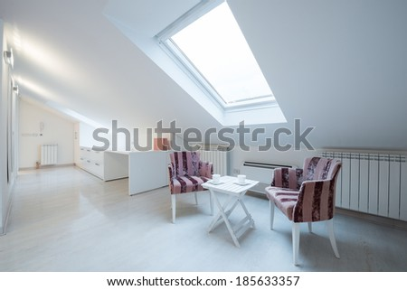 Interior of a bright white cozy loft in luxury apartment - place for relaxing