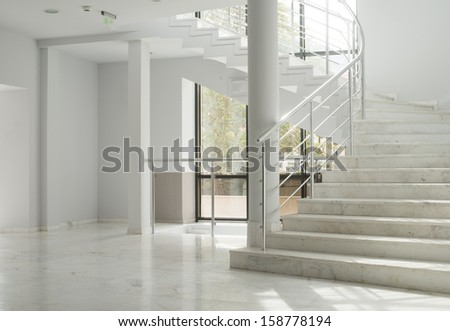 Interior of a building with white color walls. Flight of stairs - stock photo