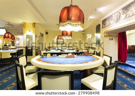 Interior of a casino with blackjack table  - stock photo