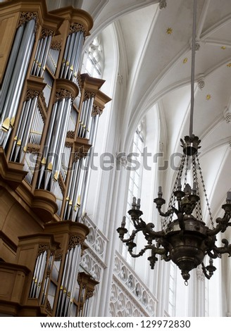 Interior of a Cathedral and pipe organ - stock photo