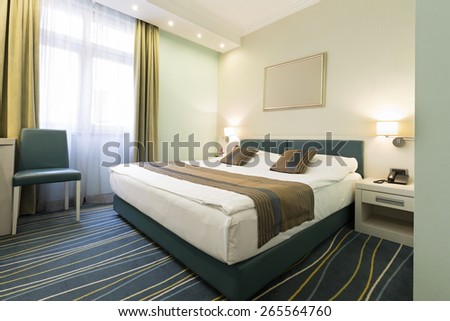 Interior of a classic style hotel bedroom - stock photo