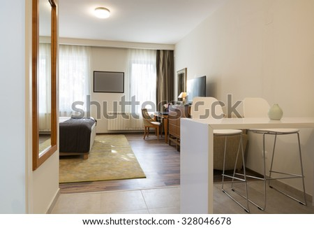 Interior of a classic styled apartment with wooden furniture - stock photo
