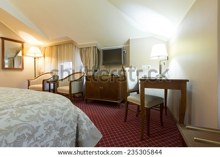 Interior of a classic styled hotel bedroom