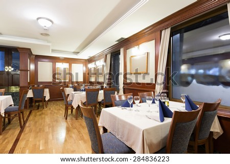 Interior of a classic styled restaurant in the evening