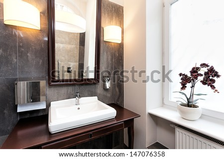 Interior of a classy bathroom with original furniture - stock photo