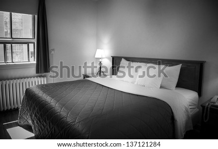 Interior of a comfortable hotel room - stock photo