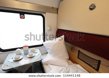 Interior of a coupe in a passenger train car - stock photo