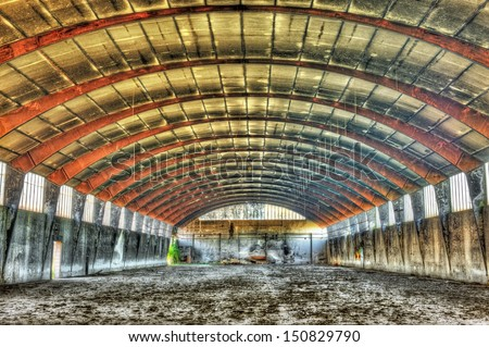 Interior of a derelict warehouse - stock photo