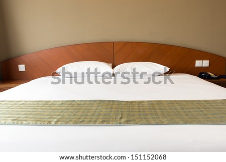 Interior of a double bed hotel bedroom - stock photo