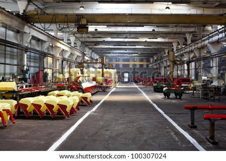 interior of a factory: pieces of agriculture tools - stock photo
