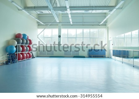 Interior of a fitness hall with sport equipment - stock photo