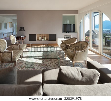 Interior of a furnished house, comfortable living room - stock photo