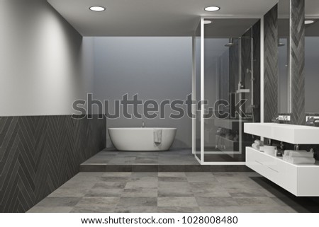 Interior of a gray bathroom with a tied floor, a white tub, and a double sink vanity unit. A shower stall in the corner. 3d rendering mock up