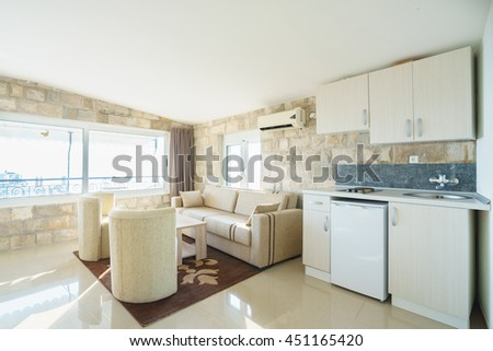 Interior of a guest house living room with kitchen - stock photo