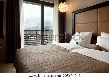 Interior of a hotel bedroom in the morning - stock photo
