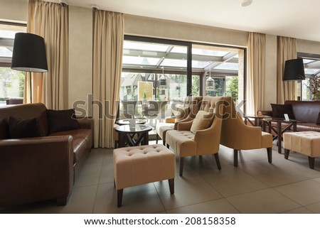 Interior of a hotel lobby with cafe  - stock photo