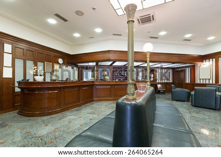 Interior of a hotel lobby with reception desk