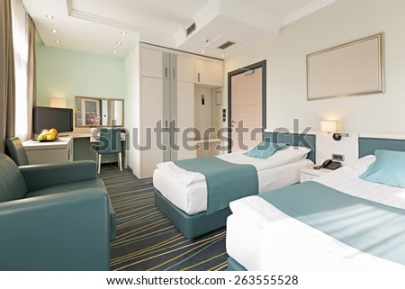 Interior of a hotel room in the morning - stock photo