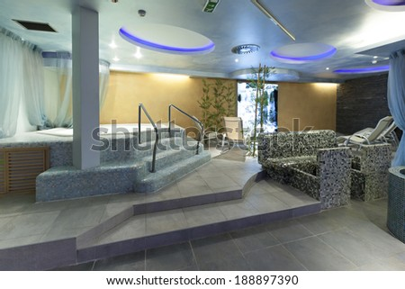 Interior of a hotel spa with jacuzzi bath  - stock photo