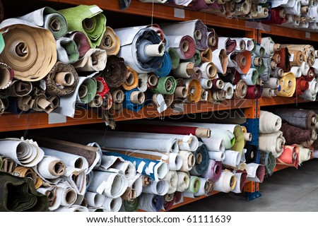 Interior of a industrial warehouse with fabric rolls.