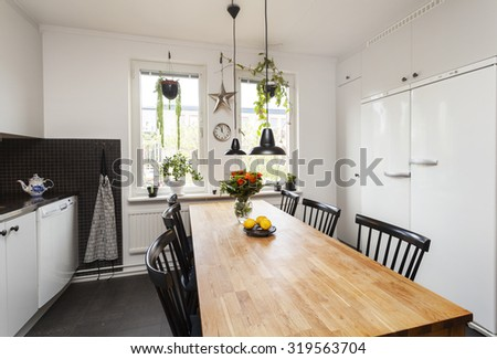 interior of a kitchen with diner-table black tile and black floor - stock photo