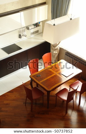 interior of a kitchen with dinning place - stock photo