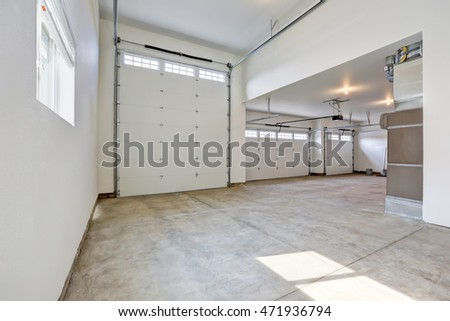 Interior of a large three car garage in a brand new house. Northwest, USA