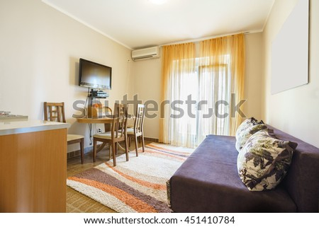Interior of a living room with kitchen in a guest house - stock photo