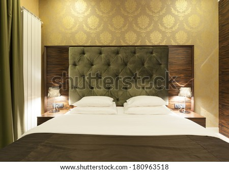 Interior of a luxury hotel bedroom in night - stock photo
