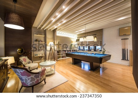 Interior of a luxury living room with billiard table - stock photo
