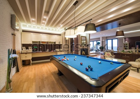Interior of a luxury living room with pool table - stock photo