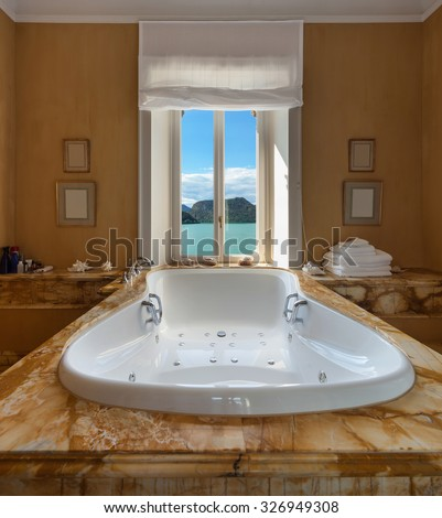 Interior of a luxury mansion, beautiful bathroom with jacuzzi - stock photo
