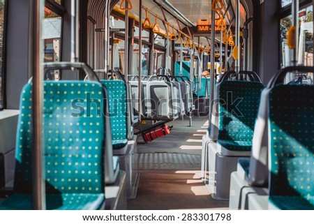 Interior of a Lviv tram with green tram seats - stock photo