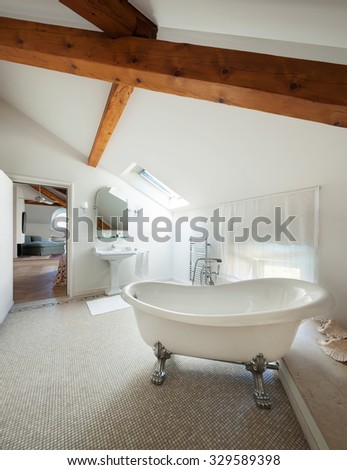 Interior of a mansion, luxury classic bathroom with  white tub - stock photo