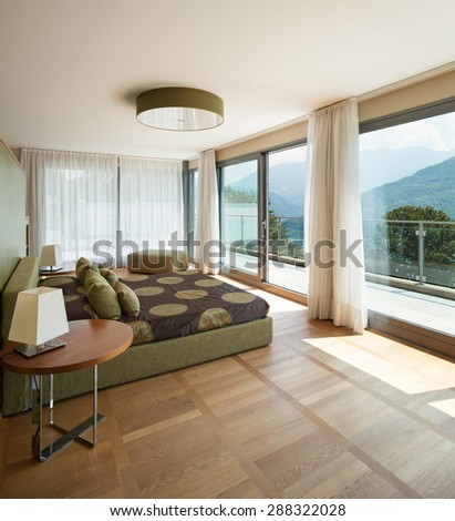 Interior of a modern apartment furnished, comfortable bedroom - stock photo