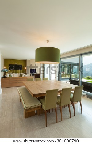 Interior of a modern apartment furnished, comfortable dining room - stock photo