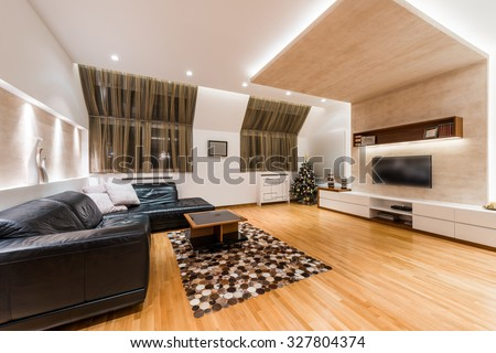 Interior of a modern apartment with Christmas tree in the evening - stock photo
