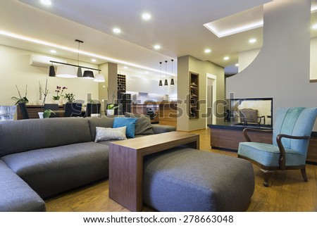 Interior of a modern apartment with fireplace - stock photo