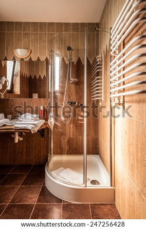 Interior of a modern bathroom. Shower cabin, basins. The vertical position photo. - stock photo