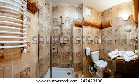 Interior of a modern bathroom. Shower cabin, basins, toilet. The horizontally position photo. - stock photo