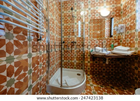 Interior of a modern bathroom. Shower cabin, basins, white towels. The horizontally position photo. - stock photo