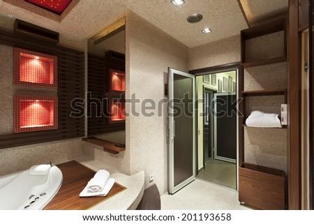 Interior of a modern bathroom with jacuzzi bath  - stock photo