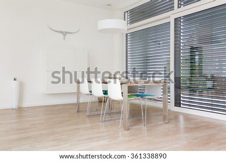 Interior of a modern bright dining-room with large windows - stock photo