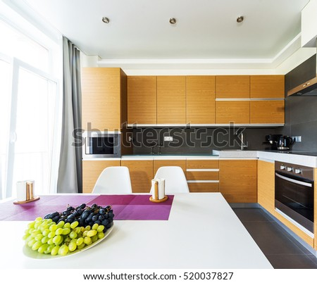 Interior of a modern bright dining-room with open kitchen