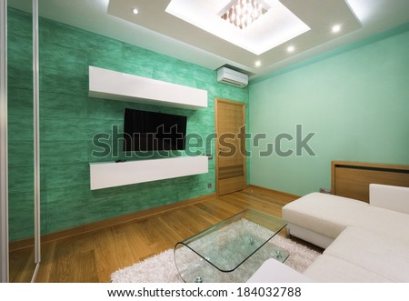 Interior of a modern green living room with luxury ceiling