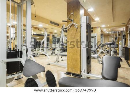 Interior of a modern gym - stock photo