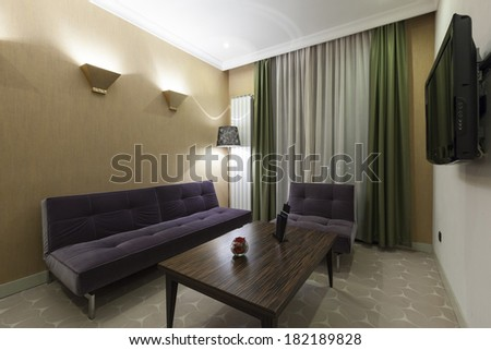 Interior of a modern hotel room in the evening