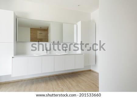 Interior of a modern house, white bathroom, marble floor  - stock photo